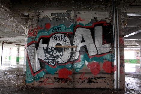 Koal graffiti at the Omnipac building on the corner of Van Horne and Parc. Photo © Kris Murray 2010.