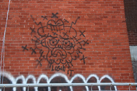 graffiti at the Omnipac building on the corner of Van Horne and Parc