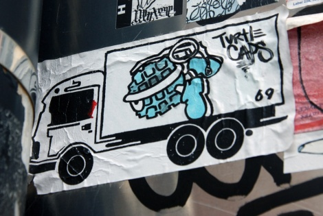 Collaboration sticker with 69 aka 6ara9e and Turtle Caps