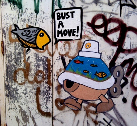 Turtle Caps wheatpaste featuring 52Hz (fish)