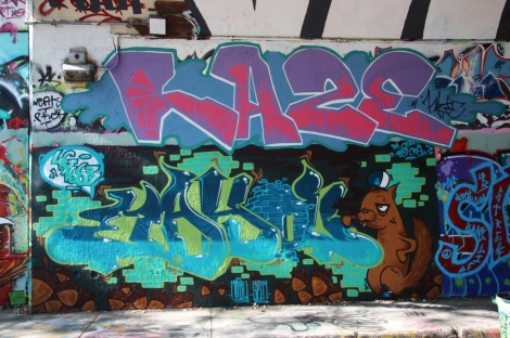 unidentified (bottom) and Haze (top) at the Rouen tunnel legal graffiti wall