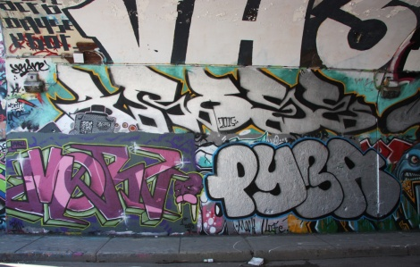 Morz (bottom left), Pyba (bottom right) and Arose (middle) at the Rouen tunnel legal graffiti wall