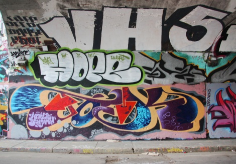 Unidentified artist (bottom) and Hoper (middle) at the Rouen legal graffiti tunnel