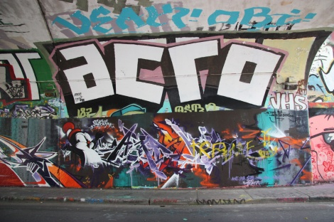 Apashe (bottom) and Acro (top) at the Rouen tunnel legal graffiti wall