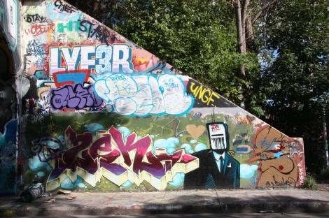 Zek (bottom letters), Earth Crusher (bottom character), Lyfer (top) at the Rouen tunnel legal graffiti wall