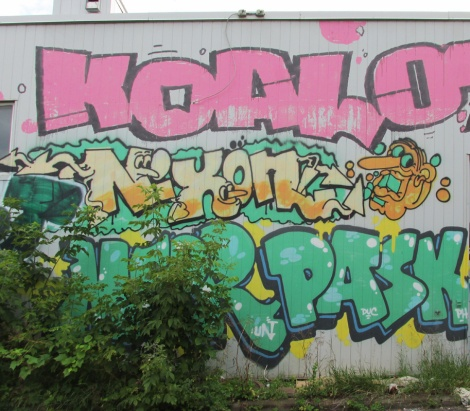 Graffiti by Koal, Nixon and Pask on back of an abandoned business in Ville-Marie