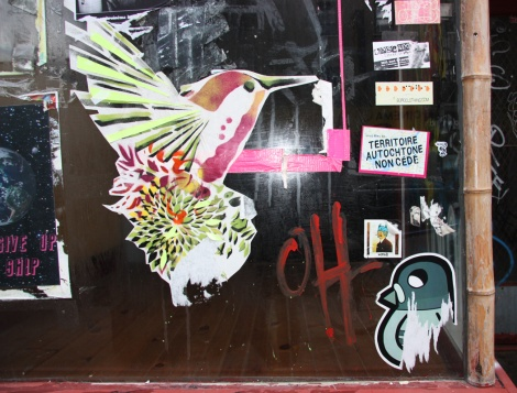 Lily Luciole wheatpaste (bird) with stickers by Decolonizing Street Art (middle right), Waxhead and ROC514 (bottom right)