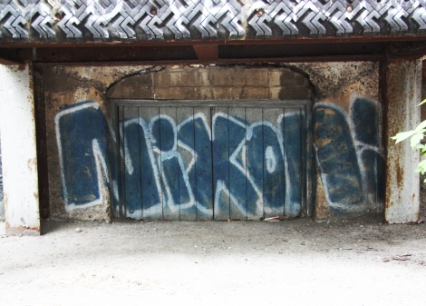 Nixon throwie underneath balcony in Mile End