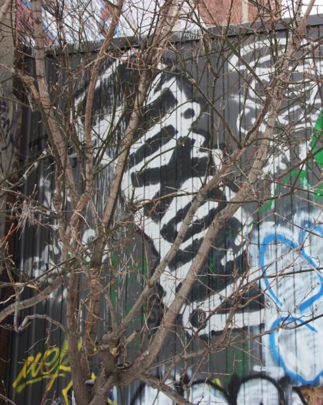 Nixon graffiti near train tracks in Mile End