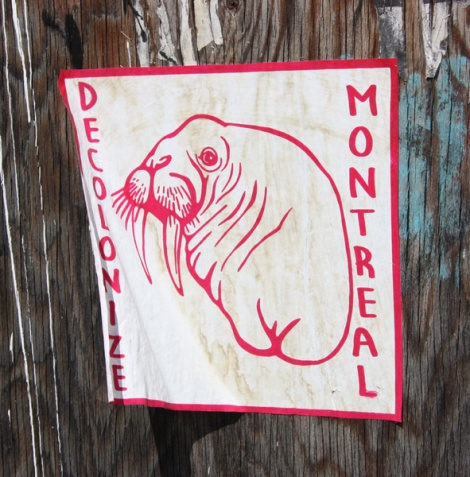 Decolonizing Street Art sticker in alley between St-Laurent and Clark