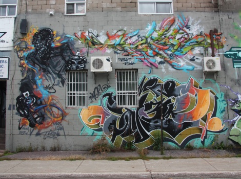 Tchug (left), Dfek (top right) and Timer (bottom right) on Cabot graffiti wall