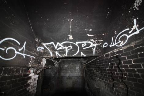 tag by Kor in an abandoned building