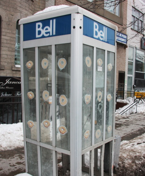 bagel wheatpastes on Parc phone booth, artist unknown