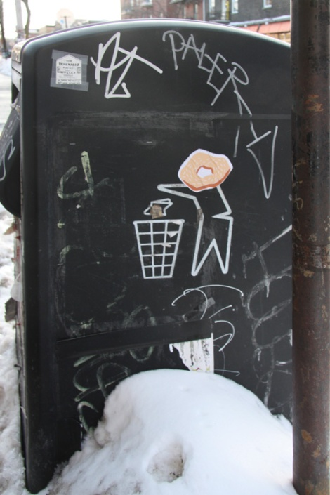 bagel wheatpastes on St-Viateur garbage, artist unknown