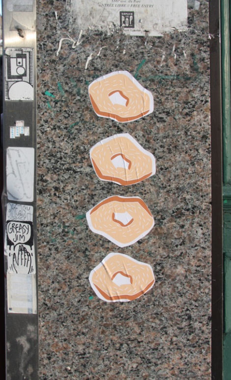 bagel wheatpastes on St-Viateur, artist unknown