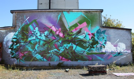 A'Shop wall featuring Shadow (middle ground level), Zek (above, plus background), Monk.e (left) and Ankh One (right)