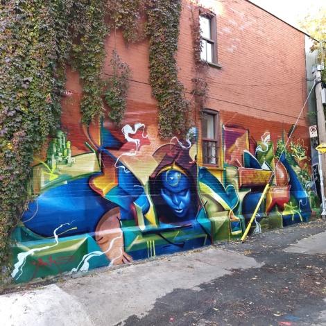 Monk.e in a graffiti alley