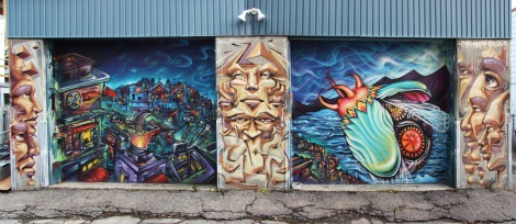 Bruno Smoky and Shalak on Hochelaga garage doors, with Monk.e in between them