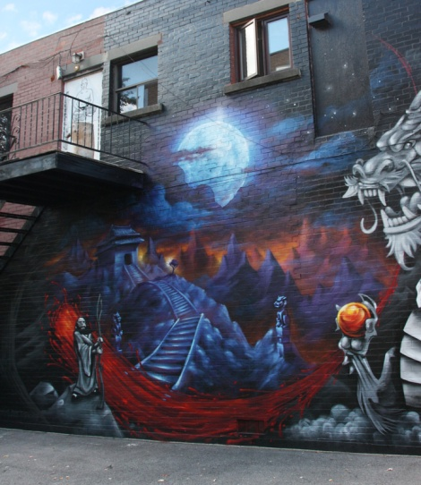 Monk.e's part in a mural collaboration with Axe and Awe in Ahuntsic