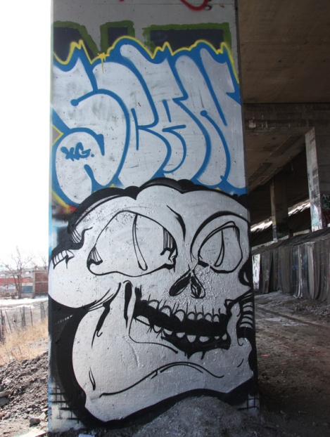 Scaner graffiti (top) and piece by unidentified artist (bottom) beneath expressway