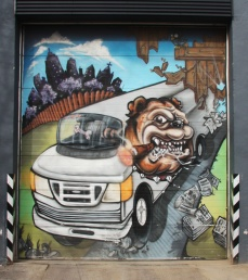 Commissioned piece on garage door by Scaner and/or Axe