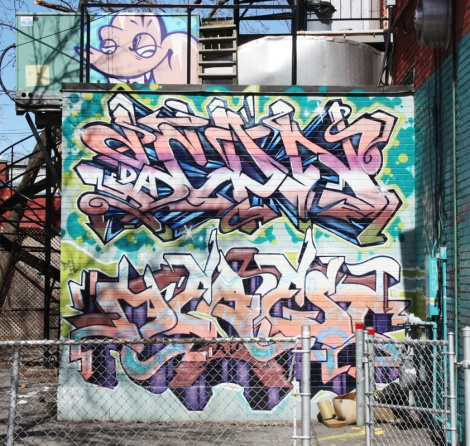Scaner (top) and unknown artist (bottom) graffiti in HoMa alley
