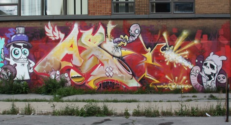 Axe piece in Hochelaga also featuring characters by Astro