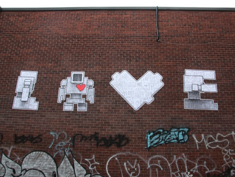 Lovebot wheatpaste near the St-Laurent axis