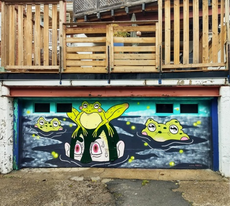 Nikki Küntzle on a garage door for the Canettes de Ruelle alley production in Rosemont