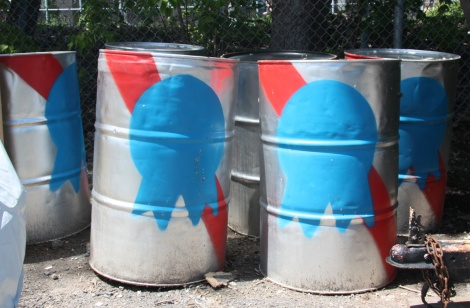 barrels painted to look like Pabst beer cans, by Earth Crusher for Chromatic Festival
