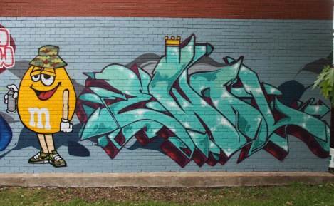 commissioned Ewol graffiti on side wall of Rosemont dépanneur