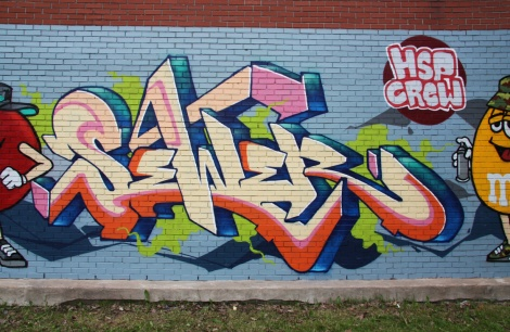commissioned Sewer graffiti on side wall of Rosemont dépanneur