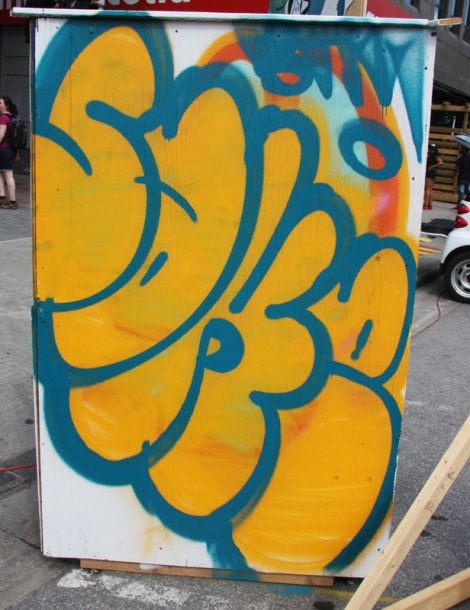 Sake throw up on the back of an information panel for the 2015 edition of Mural Festival