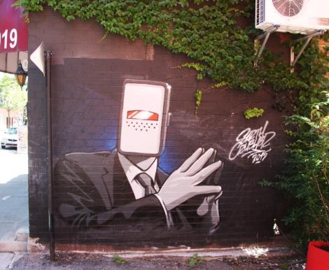 Earth Crusher piece on a Plateau café side wall