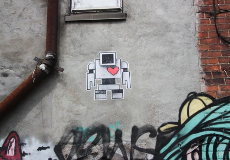 Lovebot wheatpaste in alley between St-Laurent and Clark