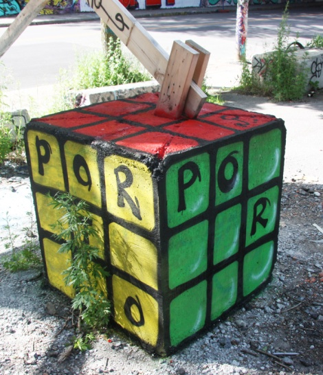 cement block painted by Porto next to the Rouen tunnel legal graffiti walls