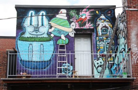 Collective work featuring Waxhead (left and bottom corner), Turtle Caps (above ladder), Futur Lasor Now (above door), Deadliest Rosa (flower) and El Moot Moot (right wall)