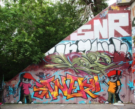 Pieces by Saner (top), Skope (middle), Saner (bottom letters) and Koni (bottom characters) at Rouen tunnel