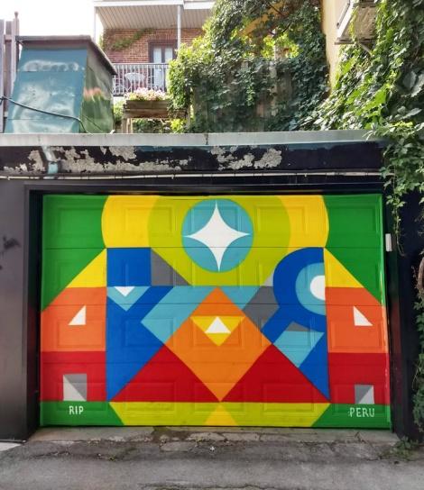 Peru Dyer on garage door in Akira's alley