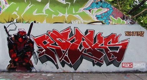 Rouks at the Rouen legal graffiti wall. Mostly visible above is Aces.