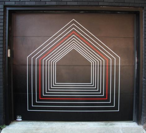 Unidentified artist on garage door