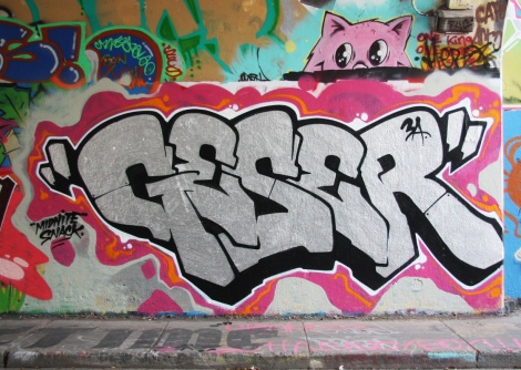 Geser at the Rouen tunnel legal graffiti walls; peeping cat above is by Mr Chose
