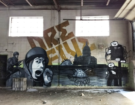 Dré aka Earth Crusher and Five Eight in an abandoned building (right half)