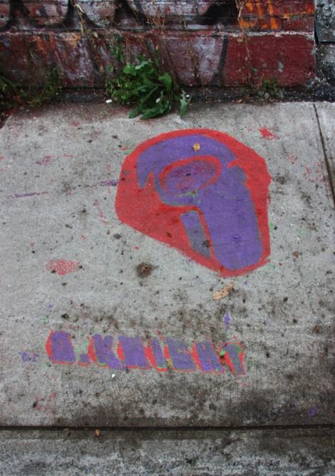 Graffiti Knight stencil on sidewalk