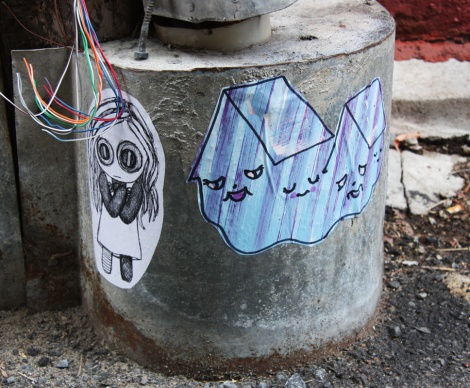paste-ups by Homsik (right) and unidentified artist (left)