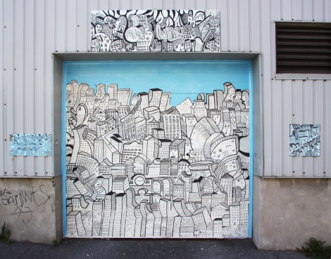 Shane Watt on garage door in Petite-Patrie