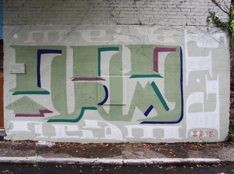 Unknown artist in Plateau alley