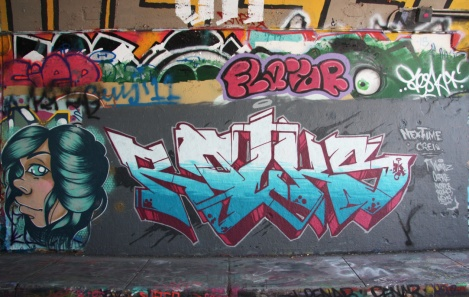 MC Baldassari (left) and Rouks (right) at the Rouen legal graffiti tunnel; above is a throwie by Flavor