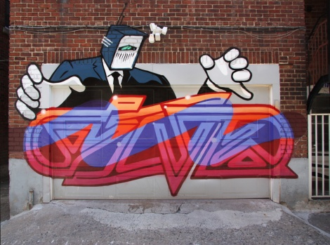 Five Eight (letters) and Earth Crusher (character) on garage door of the Plateau
