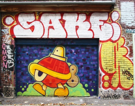Turtle Caps (on door), Sake throwie at the top, Wastoids on the right, in Plateau End alley